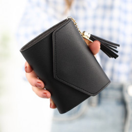 image of Woman  short wallet tassel fold over purse button
