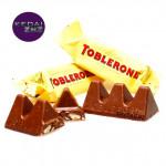 Chocolate TOBLERONE Swiss Milk Chocolate with Honey & Almond Nougat Minis 1 Piece Coklat